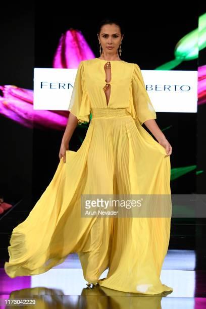 Karina Ramos walks the runway during FERNANDO ALBERTO ATELIER At New York Fashion Week Powered by Art Hearts Fashion NYFW September 2019 at The Angel...
