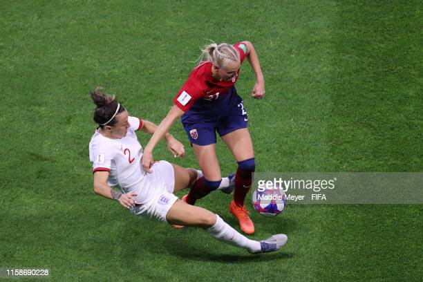 Karina Saevik of Norway is challenged by Lucy Bronze of England during the 2019 FIFA Women's World Cup France Quarter Final match between Norway and...