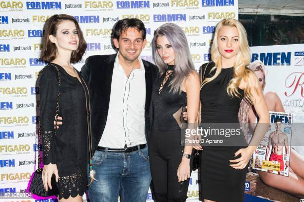 Karina Sapsai Andrea Celentano Georgia Mos and Aurora Marchesani attend For Men Magazine 2018 calendar presentation on November 6 2017 in Milan Italy