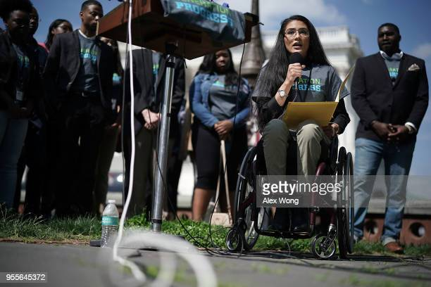 Karina Sartiaguin of Aurora Colorado a victim of a driveby shooting that have left her paralyzed from waist down speaks during a news conference on...