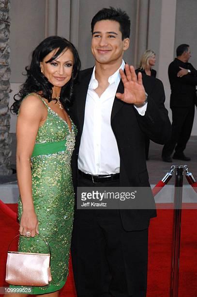 Karina Smirnoff and Mario Lopez during 2006 American Music Awards Arrivals at Shrine Auditorium in Los Angeles California United States