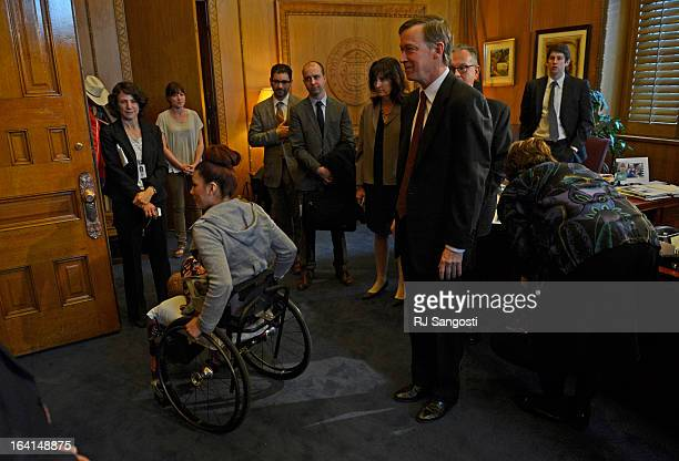 Karina Vargas who was paralyzed from a shooting outside Aurora Central High School leaves Colorado Governor John Hickenlooper's office after he...