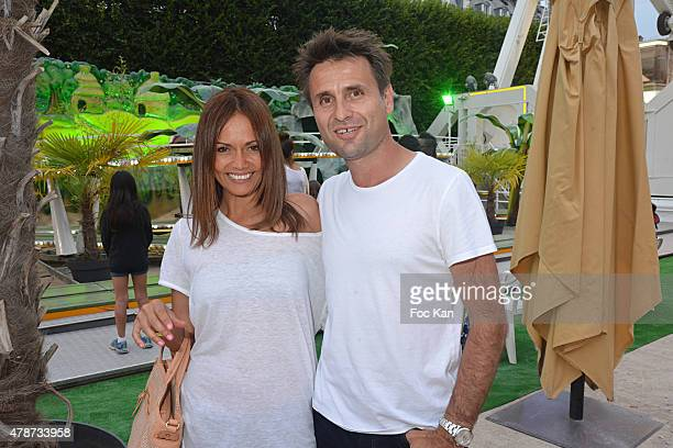 Karine Arsene and Fabrice Santoro attend 'Fete des Tuileries' Launch Party To Benefit Meghanora Association on June 26 2015 in Paris France