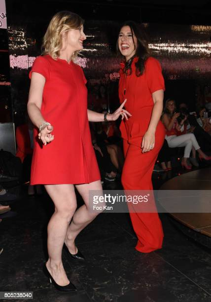 Karine De Menonville by Courreges and Nathalie Levy by Philippe Perisse walk the runway during the 'Red Defile' Auction Fashion Show Hosted by Ajila...