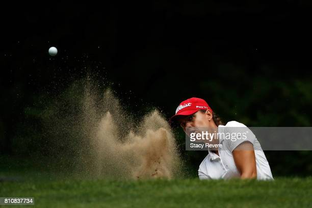 Karine Icher of France hits from a green side bunker on the first hole during the third round of the Thornberry Creek LPGA Classic at Thornberry...