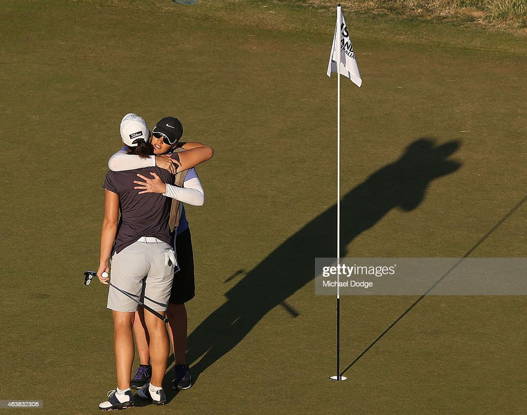 Karine Icher of France is hugged by her caddie after completing her round on the 18th hole during day one of the LPGA Australian Open at Royal Melbourne Golf Course on February 19, 2015 in Melbourne, Australia.
