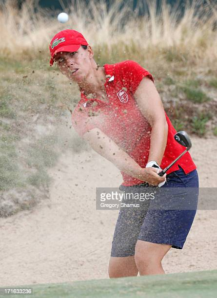 Karine Icher of France played from a green side bunker on the 18th hole during the first round of the 2013 US Women's Open at Sebonack Golf Club on...