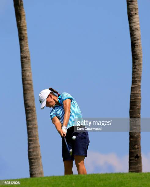 Karine Icher of France plays a shot on the 12th hole during the second round of the Pure SilkBahamas LPGA Classic at the Ocean Club course on May 25...