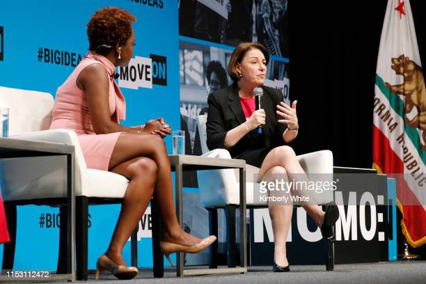 Karine JeanPierre and Amy Klobuchar speak onstage at the MoveOn Big Ideas Forum at The Warfield Theatre on June 01 2019 in San Francisco California
