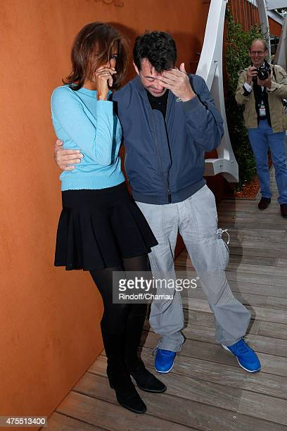 Karine Le Marchand and Stephane Plaza attend the 2015 Roland Garros French Tennis Open Day Nine on June 1 2015 in Paris France
