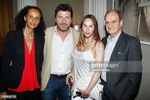 Karine Silla Philippe Lellouche his wife Vanessa Demouy and Pierre Lescure attend the Messika store launch at Apicius on June 12 2014 in Paris France
