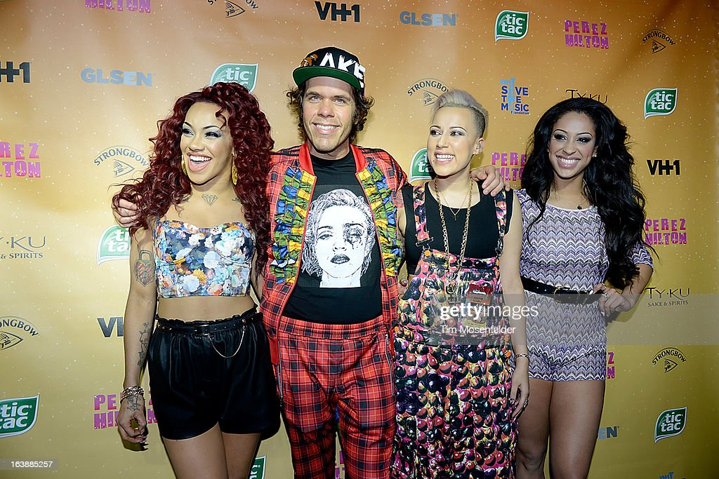 Karis Anderson, Perez Hilton, Courtney Rumbold and Alex Buggs of Stooshe pose on the red carpet for Perez Hilton's One Night In Austin event at the Austin Music Hall during the South By Southwest Music Festival on March 16, 2013 in Austin, Texas.