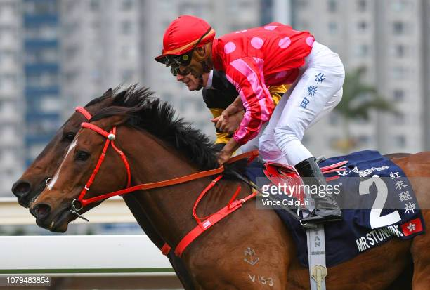 Karis Teetan riding Mr Stunning holds hands with Sam Clipperton riding D B Pin after winning in Race 5 Longines Hong Kong Sprint during the LONGINES...