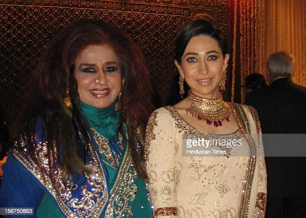 NEW DELHI INDIA OCTOBER 18 Karishma Kapoor posing with guest during SaifKareena DawateWalima at 31 Aurangzeb Road 3 on October 18 2012 in New Delhi...