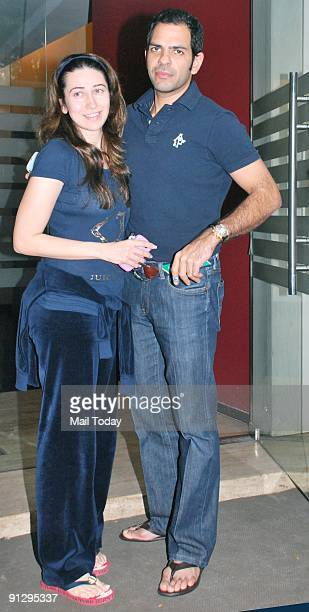 Karisma Kapoor poses with hubby Sanjay Kapur as she arrives for lunch at Royal China in Mumbai on Monday September 28 2009