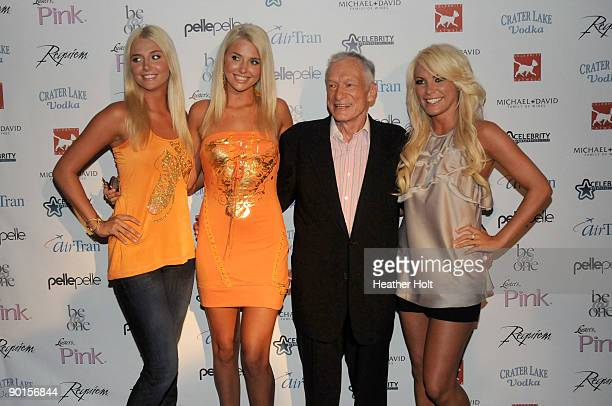 Karissa and Kristina Shannon, Hugh Hefner and Crystal Harris arrive on the red carpet at the Celebrity Catwalk's 9th Annual Fashion Show on August...