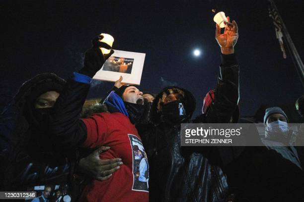 Karissa Hill, Andre Hills daughter, joins in a chant for justice during a candlelight vigil to honour her father's memory outside the Brentnell...