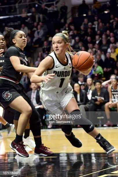 Karissa McLaughlin guard Purdue University Boilermakers breaks for the basket against Bianca CuevasMoore guard University of South Carolina Gamecocks...