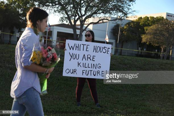 Karissa Saenz a senior at Marjory Stoneman Douglas High School holds a sign that reads ' White House You are Killing Our Future' on February 18 2018...