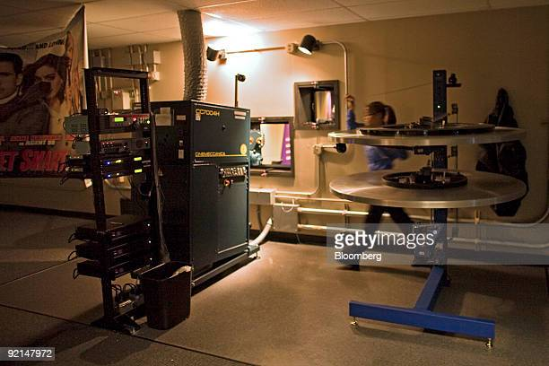 Karissa Schroeder threads a film movie projector at a Harkins movie theater in Denver Colorado US on Friday Oct 16 2009 Theater owners are converting...
