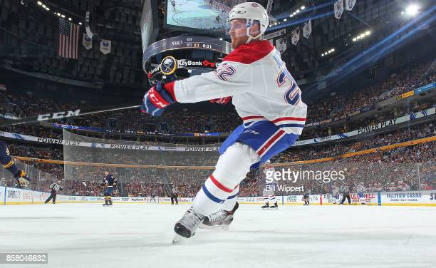 Karl Alzner of the Montreal Canadiens defends against the Buffalo Sabres during an NHL game on October 5 2017 at KeyBank Center in Buffalo New York