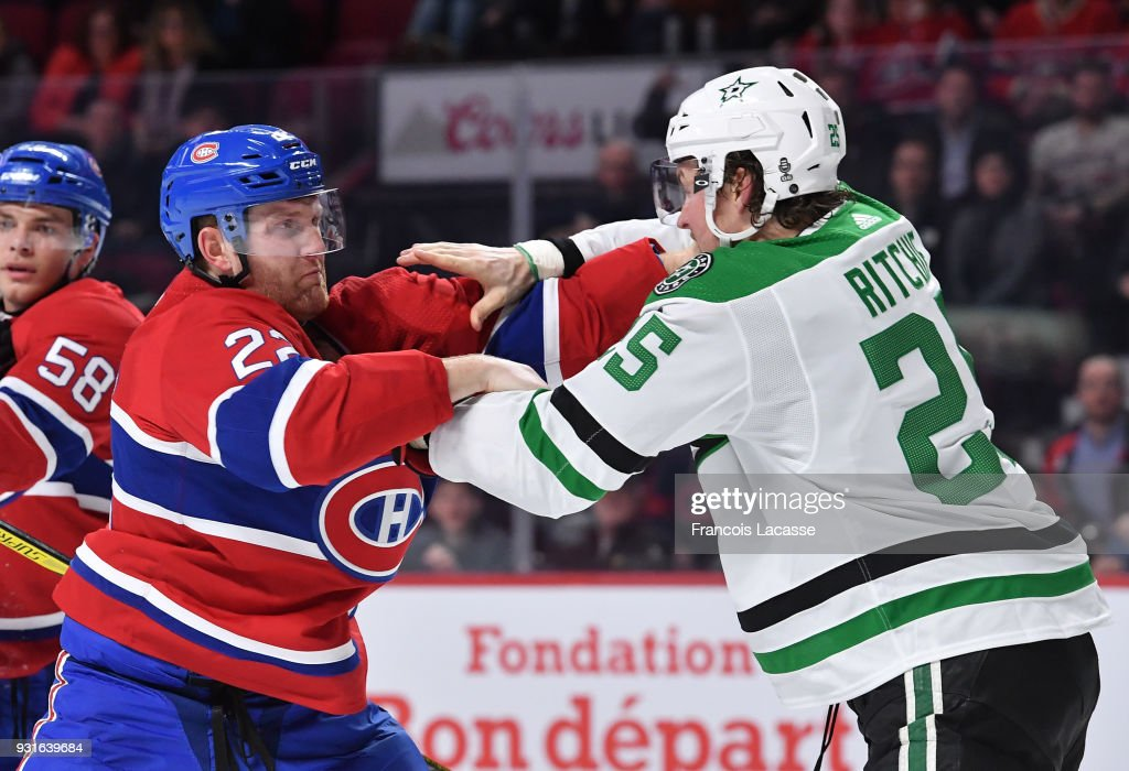 Karl Alzner #22 of the Montreal Canadiens fights Brett Ritchie #25 of the Dallas Stars in the NHL game at the Bell Centre on March 13, 2018 in Montreal, Quebec, Canada.