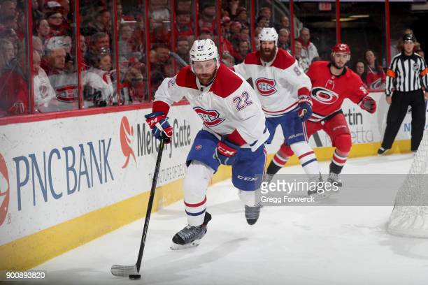 Karl Alzner of the Montreal Canadiens moves the puck along the boards during an NHL game against the Carolina Hurricanes on December 27 2017 at PNC...