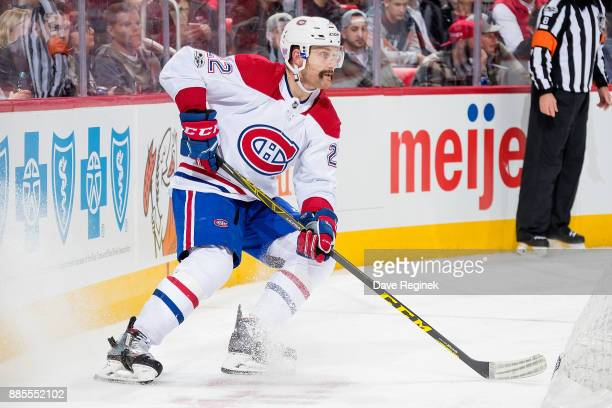 Karl Alzner of the Montreal Canadiens stops behind the net with the puck against the Detroit Red Wings during an NHL game at Little Caesars Arena on...