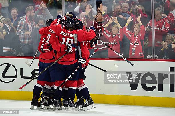 Karl Alzner of the Washington Capitals celebrates with his teammates after scoring a goal against the Colorado Avalanche in the third period during...