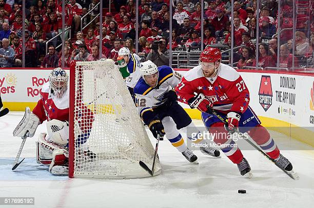 Karl Alzner of the Washington Capitals controls the puck against Jori Lehtera of the St Louis Blues in the second period during their game at Verizon...