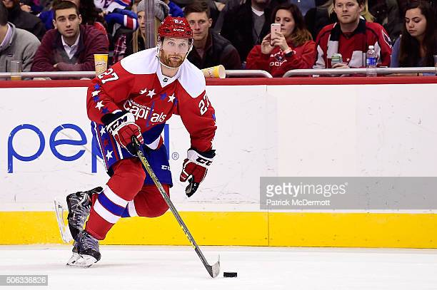 Karl Alzner of the Washington Capitals controls the puck in the third period against the New York Rangers during a game at Verizon Center on January...