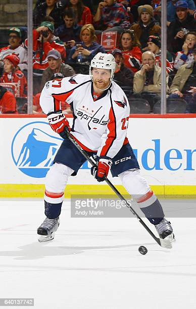 Karl Alzner of the Washington Capitals plays the puck during the game the New Jersey Devils at Prudential Center on January 26 2017 in Newark New...