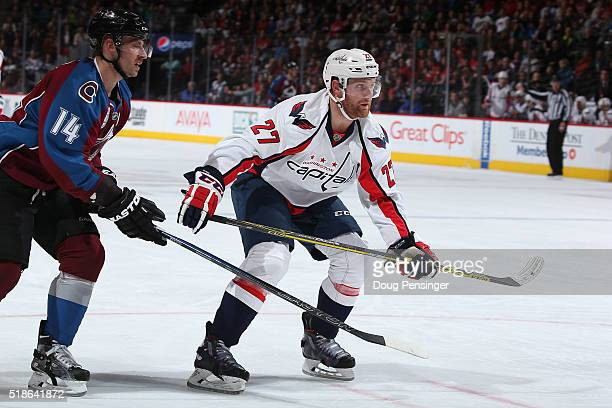 Karl Alzner of the Washington Capitals skates against Blake Comeau of the Colorado Avalanche at Pepsi Center on April 1 2016 in Denver Colorado The...
