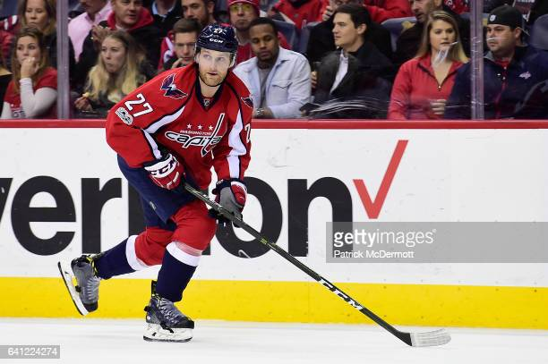 Karl Alzner of the Washington Capitals skates in the second period against the Carolina Hurricanes during an NHL game at Verizon Center on January 23...
