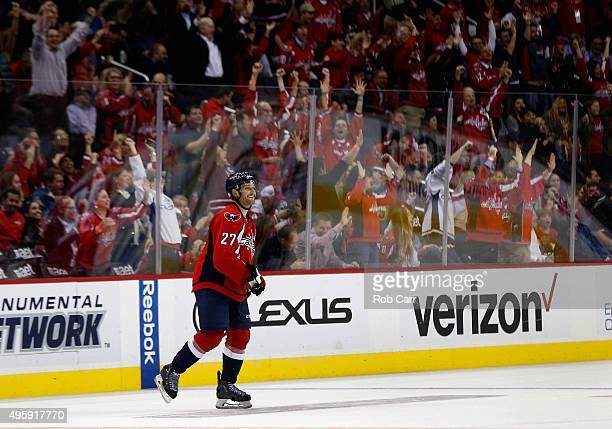 Karl Alzner of the Washington Capitals smiles after scoring a empty net goal against the Boston Bruins in the third period of their 41 win at Verizon...