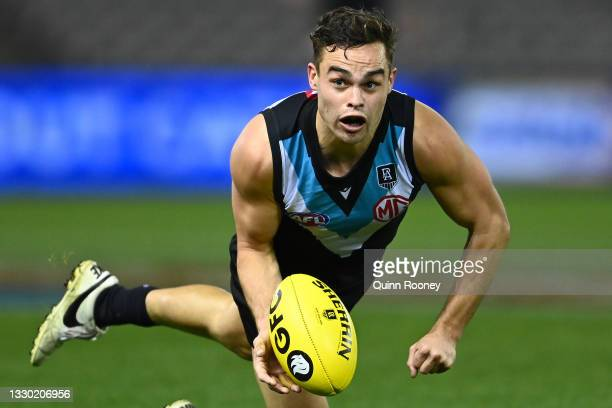 Karl Amon of the Power handballs during the round 19 AFL match between Port Adelaide Power and Collingwood Magpies at Marvel Stadium on July 23, 2021...