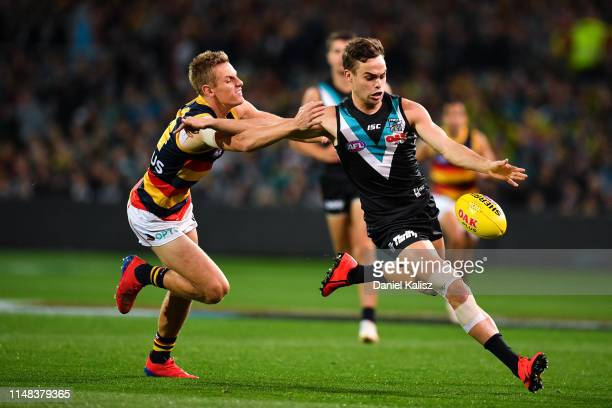 Karl Amon of the Power kicks the ball during the round eight AFL match between the Port Adelaide Power and the Adelaide Crows at Adelaide Oval on May...