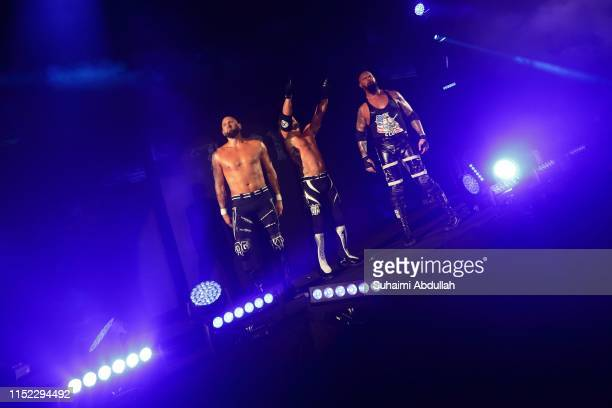 Karl Anderson, AJ Styles and Luke Gallows in action during the WWE Live Singapore at the Singapore Indoor Stadium on June 27, 2019 in Singapore.