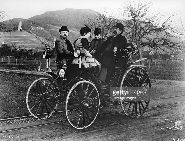 Karl Benz with his wife Bertha in a BenzViktoria 1893 Karl Benz is on the right sitting next to his wife His daughter sits opposite him next to a...