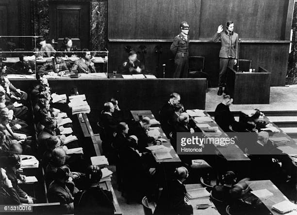Karl Brandt takes the witness stand in his own defense to be the first defendant at the Nuremberg Trials held in the Palace of Justice The trials...