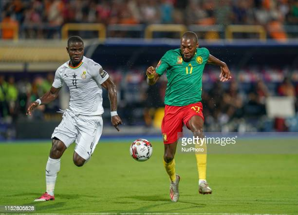 Karl Brillant Toko Ekambi of Cameroon and Jonathan Mensah of Ghana challenging for the ball during the 2019 African Cup of Nations match between...