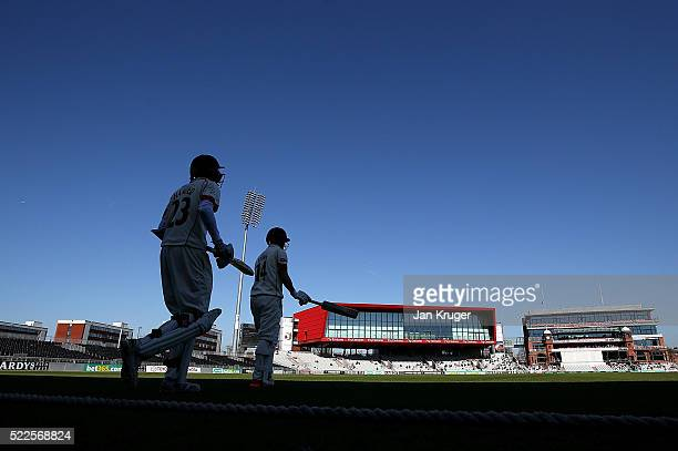 Karl Brown and Haseeb Hameed of Lancashire make their way out to bat during day four of the Specsavers County Championship Division One match between...
