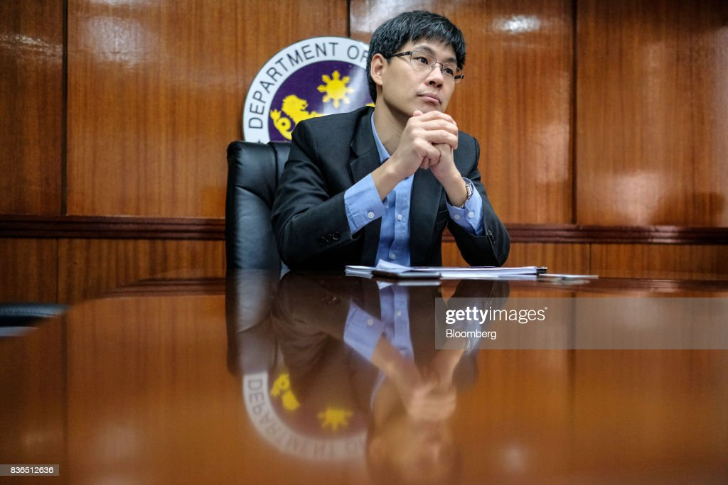 Karl Chua, the Philippines' finance undersecretary, listens during an interview in Manila, the Philippines, on Monday, Aug. 14, 2017. The Philippines risks slower growth and a credit rating downgrade if lawmakers water down the government's tax reform plan, the finance department has warned. Photographer: Veejay Villafranca/Blooomberg
