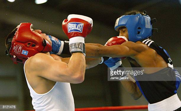 Karl Dargan punches Anthony Vasquez in bout during the United States Olympic Team Boxing Trials at Battle Arena on February 19 2004 in Tunica...