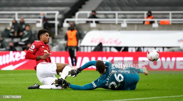 Karl Darlow of Newcastle United saves from Marcus Rashford of Manchester United during the Premier League match between Newcastle United and...