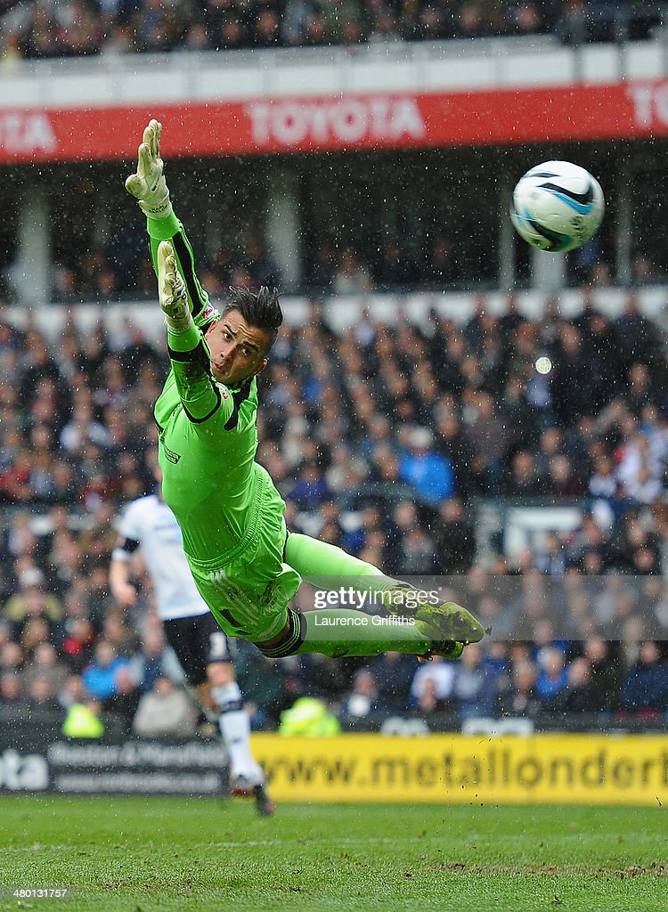 Karl Darlow of Nottingham Forest in action during the Sky Bet Championship match between Derby County and Nottingham Forest at iPro Stadium on March 23, 2014 in Derby, England.