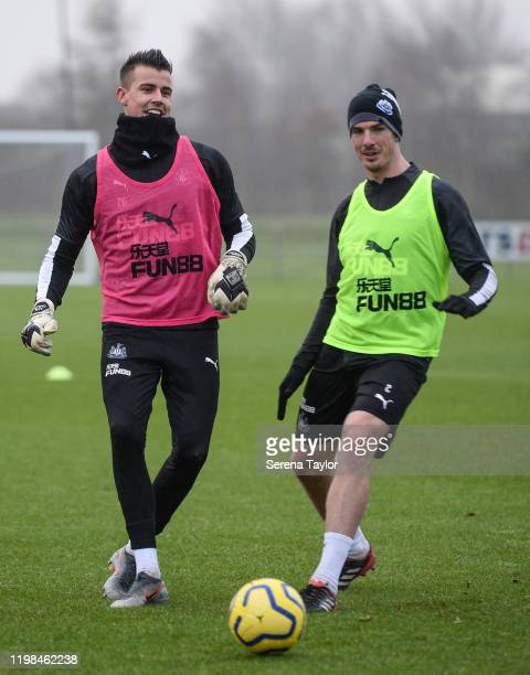 Karl Darlow passes the ball as Ciaran Clark attempts to intercept during the Newcastle United Training Session at the Newcastle United Training...