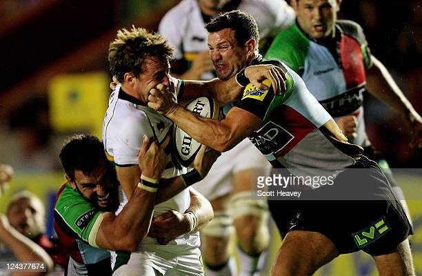 Karl Dickson and Chris York of Harlequins bring diwn Martin Roberts of Northampton during the AVIVA Premiership match between Harlequins and...