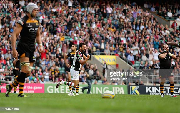 Karl Dickson of Harlequins is congratulated by team mate Jordan TurnerHall after scoring a try during the Aviva Premiership match between London...
