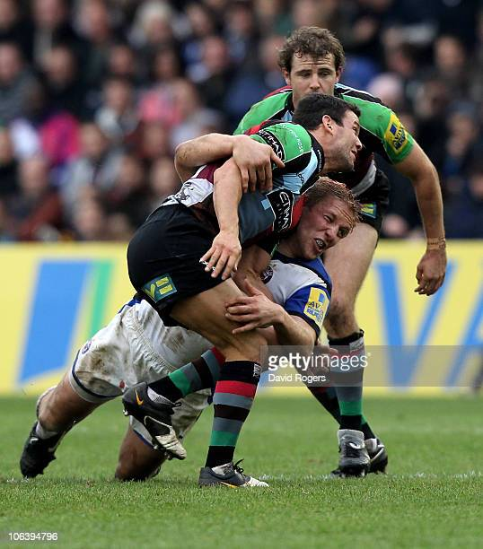 Karl Dickson of Harlequins is tackled by Lewis Moody during the Aviva Premiership match between Harlequins and Bath at the Stoop on October 31 2010...